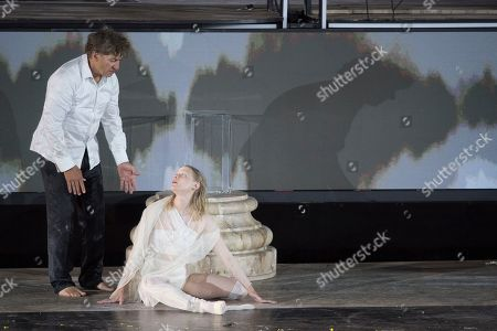 Tobias Moretti as Jedermann (left) and Mavie Hoerbiger as Werke perform on stage during a rehearsal of Hugo von Hofmannsthal's Jedermann (Everyman) at the Domplatz square in Salzburg, Austria, 16 July 2019 (issued 17 July 2019). The play Jedermann, one of the highlights of the Salzburg festival, which was established in 1920, runs from 20 July to 31 August 2019.