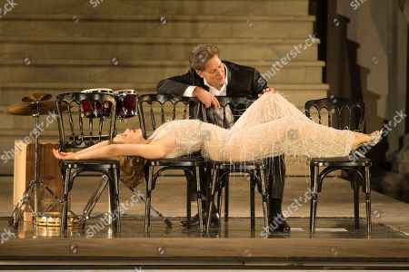 Valery Tscheplanowa as Buhlschaft (down) and Tobias Moretti as Jedermann perform on stage during a rehearsal of Hugo von Hofmannsthal's Jedermann (Everyman) at the Domplatz square in Salzburg, Austria, 16 July 2019 (issued 17 July 2019). The play Jedermann, one of the highlights of the Salzburg festival, which was established in 1920, runs from 20 July to 31 August 2019.