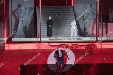 Georg Bloeb as devil (front), Falk Rockstroh as Glaube (back left) and Mavie Hoerbiger as Werke perform on stage during a rehearsal of Hugo von Hofmannsthal's Jedermann (Everyman) at the Domplatz square in Salzburg, Austria, 16 July 2019 (issued 17 July 2019). The play Jedermann, one of the highlights of the Salzburg festival, which was established in 1920, runs from 20 July to 31 August 2019.