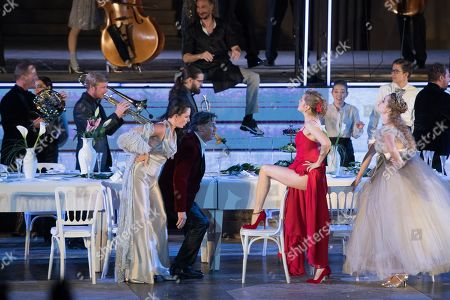 Tobias Moretti as Jedermann (2-L) and Valery Tscheplanowa as Buhlschaft (2-R) perform on stage during a rehearsal of Hugo von Hofmannsthal's Jedermann (Everyman) at the Domplatz square in Salzburg, Austria, 16 July 2019 (issued 17 July 2019). The play Jedermann, one of the highlights of the Salzburg festival, which was established in 1920, runs from 20 July to 31 August 2019.