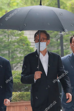 Stock Image of Former President Lee Myung-bak arrives at the Seoul High Court, in Seoul, Sourth Korea, 17 July 2019, to attend a hearing. Lee, who was released on bail from a detention center on 06 March 2019, is appealing a 15-year sentence for bribery, embezzlement and other acts of corruption.