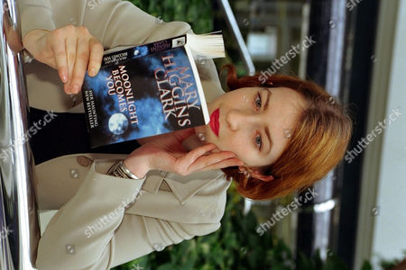 Daily Mail Femail Researcher Harriett Margolis Reading The Book Moonlight Becomes You By Mary Higgins Clark. Scottish Daily Mail Reader Offer.