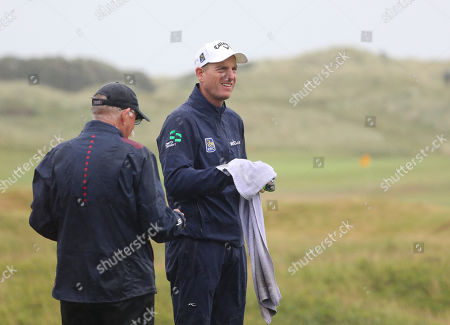 Jim Furyk of the United States cleans a club with a towel on the practice range ahead of the start of the British Open golf championships at Royal Portrush in Northern Ireland, . The British Open starts Thursday