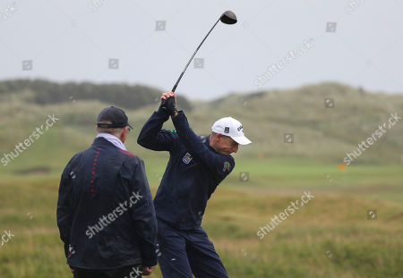Jim Furyk of the United States prepares to make a shot on the practice range ahead of the start of the British Open golf championships at Royal Portrush in Northern Ireland, . The British Open starts Thursday