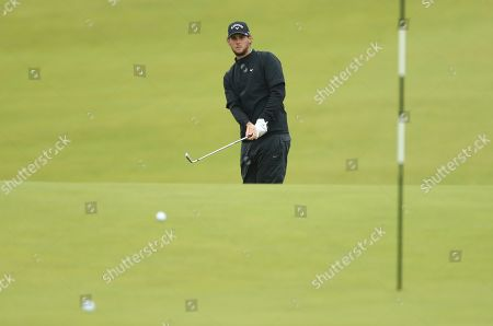 Belgium's Thomas Pieters putts onto the 9th green during a practice round ahead of the start of the British Open golf championships at Royal Portrush in Northern Ireland, . The British Open starts Thursday