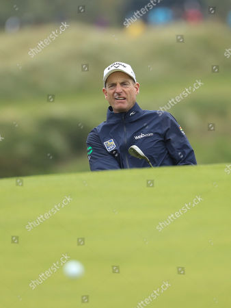 Jim Furyk of the United States looks up after chipping on to the 3rd green during a practice round ahead of the start of the British Open golf championships at Royal Portrush in Northern Ireland, . The British Open starts Thursday