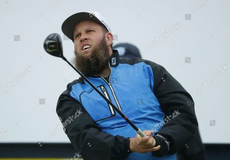 Stock Photo of England's Andrew Johnston plays a shot from the 16th tee during a practice round ahead of the start of the British Open golf championships at Royal Portrush in Northern Ireland,. The British Open starts Thursday