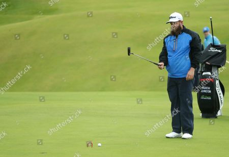 Stock Photo of England's Andrew Johnston lines up a putt on the 15th green during a practice round ahead of the start of the British Open golf championships at Royal Portrush in Northern Ireland,. The British Open starts Thursday