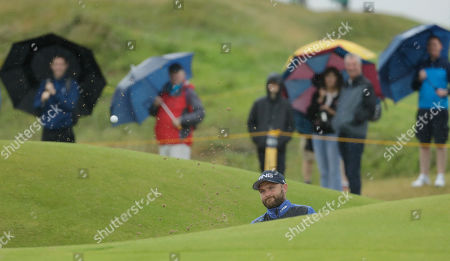 England's Andy Sullivan plays out of a bunker on the 15th green during a practice round ahead of the start of the British Open golf championships at Royal Portrush in Northern Ireland,. The British Open starts Thursday