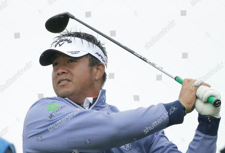 Thailand's Kiradech Aphibarnrat plays his tee shot at the 16th during a practice round ahead of the start of the British Open golf championships at Royal Portrush in Northern Ireland, . The British Open starts Thursday