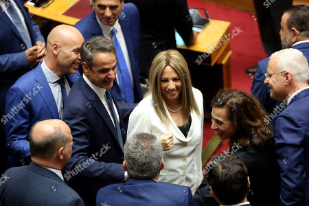 Greek Prime Minister Kyriakos Mitsotakis (C) and leader of KINAL opposition party Fofi Gennimata (C-L) attend a swearing in ceremony for the new members of parliament at the Greek Parliament, in Athens, Greece, on 17 July 2019.