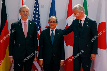 French Finance Minister Bruno Le Maire, right, welcomes Italian Economy and Finance Minister Giovanni Tria, center, with Governor of the Bank of France Francois Villeroy de Galhau, at the G-7 Finance .The top finance officials of the Group of Seven rich democracies are arriving at Chantilly, at the start of a two-day meeting aimed at finding common ground on how to tax technology companies and on the risk from new digital currencies