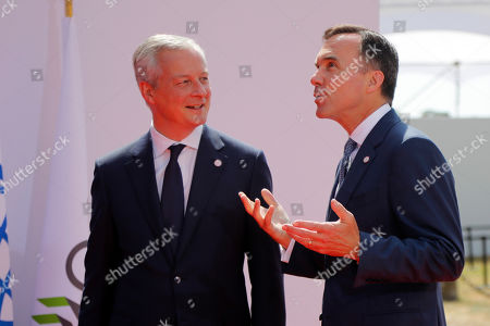 French Finance Minister Bruno Le Maire, left, welcomes Canada's Finance Minister Bill Morneau, at the G-7 Finance .The top finance officials of the Group of Seven rich democracies are arriving at Chantilly, at the start of a two-day meeting aimed at finding common ground on how to tax technology companies and on the risk from new digital currencies