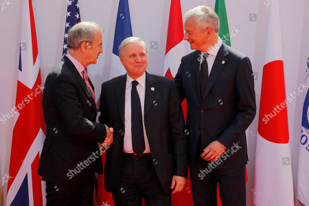 Stock Picture of French Finance Minister Bruno Le Maire, right, welcomes Bank of Italy Governor Ignazio Visco, center, with Governor of the Bank of France Francois Villeroy de Galhau, at the G-7 Finance .The top finance officials of the Group of Seven rich democracies are arriving at Chantilly, at the start of a two-day meeting aimed at finding common ground on how to tax technology companies and on the risk from new digital currencies