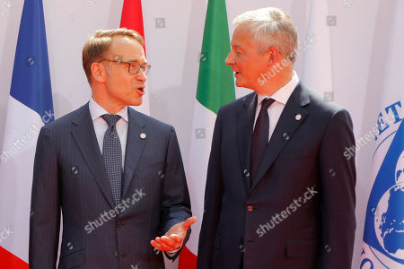 French Finance Minister Bruno Le Maire, right, welcomes German Bundesbank President Jens Weidmann at the G-7 Finance in Chantilly, north of Paris. The Group of Seven rich democracies' top finance officials gathered Wednesday at a chateau near Paris in search of common ground on the threats posed by digital currencies