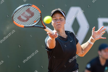 Liudmila Samsonova, of Russia, returns a ball to Xinyun Han, of China, during the second round match, at the WTA International Ladies Open Lausanne tournament, in Lausanne, Switzerland, Wednesday, July 17, 2019.