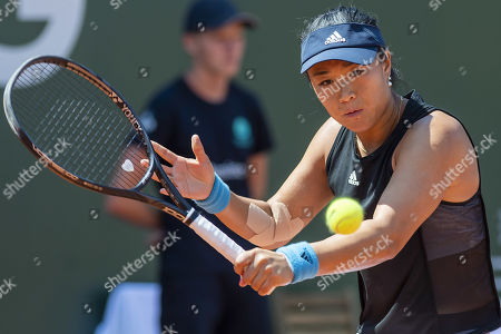 Xinyun Han, of China, returns a ball to Liudmila Samsonova, of Russia, during the second round match, at the WTA International Ladies Open Lausanne tournament, in Lausanne, Switzerland, Wednesday, July 17, 2019.