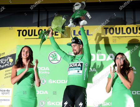 Slovakia's Peter Sagan wearing the best sprinter's green jersey celebrates on the podium after the eleventh stage of the Tour de France cycling race over 167 kilometers (103,77 miles) with start in Albi and finish in Toulouse, France