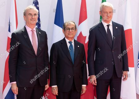 French finance minister Bruno Le Maire (R) and Governor of the Bank of France, Francois Villeroy de Galhau (L) greet Italian finance minister Giovanni Tria as he arrives for the G7 Finance Summit in Chantilly, France, 17 July 2019.