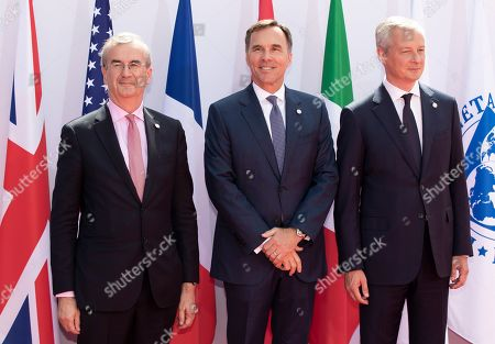 Stock Photo of French finance minister Bruno Le Maire (R) and Governor of the Bank of France, Francois Villeroy de Galhau (L) greet Canadian finance minister Bill Morneau as he arrives for the G7 Finance Summit in Chantilly, France, 17 July 2019.