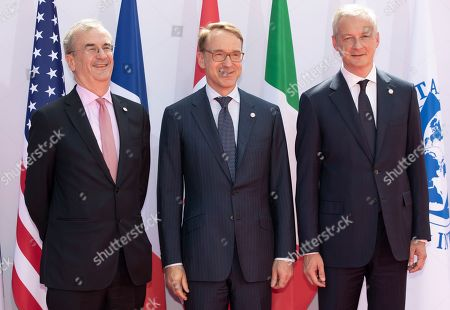 French finance minister Bruno Le Maire (R) and Governor of the Bank of France, Francois Villeroy de Galhau (L) greet President of the Deutsche Bank Jens Weidmann as he arrives for the G7 Finance Summit in Chantilly, France, 17 July 2019.