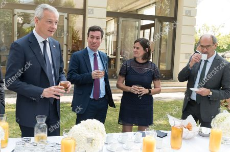 Bruno Le Maire, a guest, Izabella Wojtowicz and Eric Woerth.