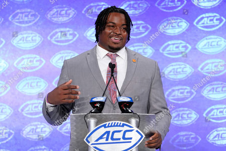 Clemson's John Simpson speaks during the Atlantic Coast Conference NCAA college football media day in Charlotte, N.C