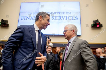 Stock Photo of David Marcus, Patrick McHenry. David Marcus, CEO of Facebook's Calibra digital wallet service, left, and Ranking Member Rep. Patrick McHenry, R-N.C., right, speak before a House Financial Services Committee hearing on Facebook's proposed cryptocurrency on Capitol Hill in Washington