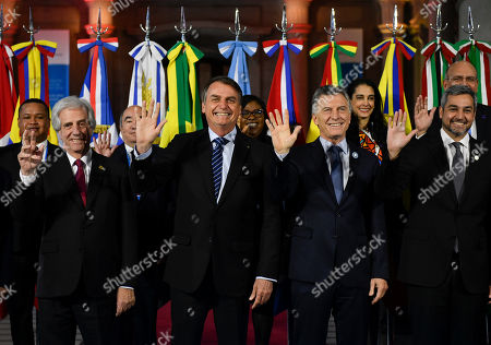 Leaders, from left, front, Uruguay's President Tabare Vazquez, Brazil's President Jair Bolsonaro, Argentina's President Mauricio Macri and Paraguay's President Mario Abdo Benitez, pose for photographers at the Mercosur Summit in Santa Fe, Argentina, . The South American trading bloc that includes founding members Brazil, Argentina, Paraguay, and Uruguay, is one of the world's largest