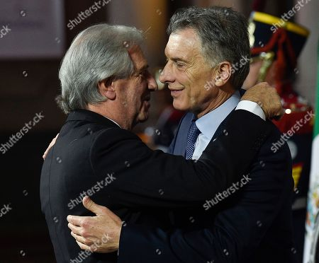 Argentina's President Mauricio Macri, right, embraces Uruguay's Presidente Tabare Vazquez at the Mercosur Summit in Santa Fe, Argentina, . The South American trading bloc that includes founding members Brazil, Argentina, Paraguay, and Uruguay, is one of the world's largest
