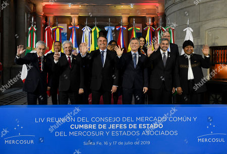 Leaders, from left, Chile's President Sebastian Pinera, Uruguay's President Tabare Vazquez, Brazil's President Jair Bolsonaro, Argentina's President Mauricio Macri, Paraguay's President Mario Abdo Benitez and Bolivia's President Evo Morales pose for photographers at the Mercosur Summit in Santa Fe, Argentina, . The South American trading bloc that includes founding members Brazil, Argentina, Paraguay, and Uruguay, is one of the world's largest