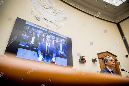 An image of Facebook CEO Mark Zuckerberg is visible on a screen behind David Marcus, CEO of Facebook's Calibra digital wallet service, right, as he is questioned by Rep. Brad Sherman, D-Calif., during a House Financial Services Committee hearing on Facebook's proposed cryptocurrency on Capitol Hill in Washington
