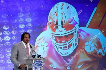 Clemson 's John Simpson speaks during the Atlantic Coast Conference NCAA college football media day in Charlotte, N.C