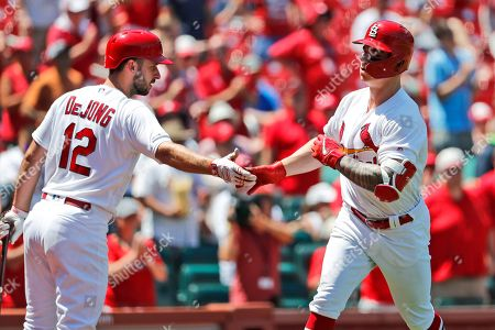St. Louis Cardinals' Tyler O'Neill, right, is congratulated by teammate Paul DeJong after hitting a solo home run during the fifth inning of a baseball game against the Pittsburgh Pirates, in St. Louis