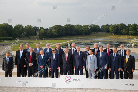 From left, Bank of Japan governor Haruhiko Kuroda, World Bank President David Malpass, Eurogroup President Mario Centeno, British Chancellor of the Exchequer Philip Hammond, Bank of Canada Governor Stephen Poloz, German Finance Minister Olaf Scholz, Federal Reserve Chair Jerome Powell, US Treasury Secretary Steve Mnuchin, Bank of England Governor Mark Carney, Bank of France Governor Francois Villeroy de Galhau, European Commissioner for Economic and Financial Affairs Pierre Moscovici, French Finance Minister Bruno Le Maire, Italian Economy and Finance Minister Giovanni Tria, Japan's Finance Minister Taro Aso, Organization for Economic Cooperation and Development (OECD) Secretary-General Angel Gurria, Canada's Finance Minister Bill Morneau, European Central Bank President Mario Draghi, German Bundesbank President Jens Weidmann, Bank of Italy Governor Ignazio Visco and International Monetary Fund (IMF) Deputy Managing Director David Lipton pose for a group photo at the G-7 Finance in Chantilly, north of Paris, on