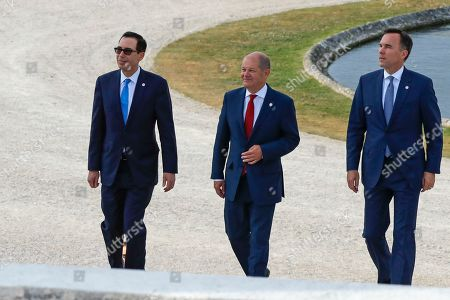 Stock Image of Steve Mnuchin, Olaf Scholz, Bill Morneau. US Treasury Secretary Steve Mnuchin, German Finance Minister Olaf Scholz and Canada's Finance Minister Bill Morneau, from left, walk at the G-7 Finance in Chantilly, north of Paris, on . The Group of Seven rich democracies' top finance officials gathered Wednesday at a chateau near Paris in search of common ground on the threats posed by digital currencies