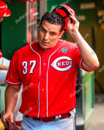 Cincinnati Reds relief pitcher David Hernandez takes off his cap after giving up two walks and a two RBI double in the seventh inning of the MLB game between the Cincinnati Reds and the Chicago Cubs at Wrigley Field in Chicago, Illinois, USA, 17 July 2019.