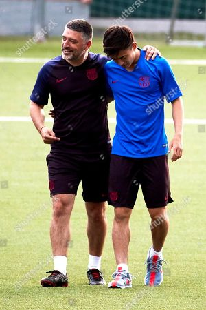 FC Barcelona's Japanese forward Hiroki Abe (R) and coach Francisco Javier Garcia Pimienta (L) attend a training session of the FC Barcelona B team at the Sant Joan Despi facilities in Barcelona, Spain, 17 July 2019.