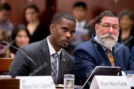St. Paul Mayor Melvin Carter, left, accompanied by Pittsburgh Mayor Bill Peduto, right, speaks during a Senate Democrats' Special Committee on the Climate Crisis on Capitol Hill in Washington