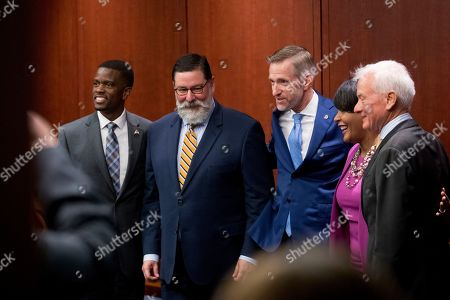 From left, St. Paul Mayor Melvin Carter, Pittsburgh Mayor Bill Peduto, Portland Mayor Ted Wheeler, Atlanta Mayor Keisha Lance Bottoms, and Honolulu Mayor Kirk Caldwell, pose for a photograph before a Senate Democrats' Special Committee on the Climate Crisis on Capitol Hill in Washington