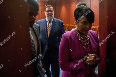 From left, St. Paul Mayor Melvin Carter, Pittsburgh Mayor Bill Peduto, and Atlanta Mayor Keisha Lance Bottoms, arrive for a Senate Democrats' Special Committee hearing on the Climate Crisis on Capitol Hill in Washington