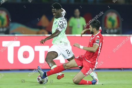 Nigeria's Temitayo Aina and Tunisia's Ferjani Sassi fight for the ball during the African Cup of Nations third place soccer match between Nigeria and Tunisia in Al Salam stadium in Cairo, Egypt