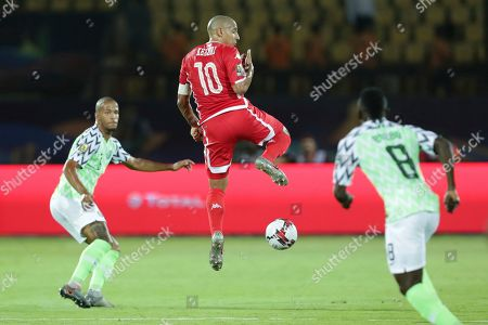 Tunisia's Wahbi Khazri jumps for the ball during the African Cup of Nations third place soccer match between Nigeria and Tunisia in Al Salam stadium in Cairo, Egypt