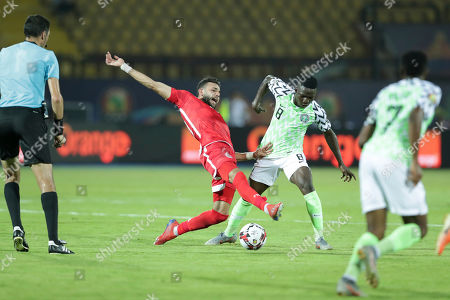 Nigeria's Oghenekaro Etebo and Tunisia's Ghaylen Chaaleli fight for the ball during the African Cup of Nations third place soccer match between Nigeria and Tunisia in Al Salam stadium in Cairo, Egypt
