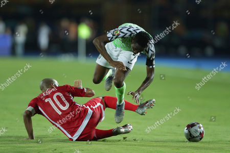 Tunisia's Wahbi Khazri tackles Nigeria's Ahmed Musa during the African Cup of Nations third place soccer match between Nigeria and Tunisia in Al Salam stadium in Cairo, Egypt