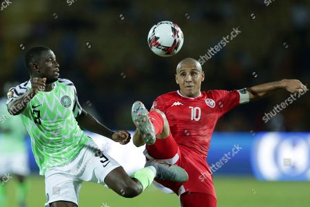 Tunisia's Wahbi Khazri and Nigeria's Jamilu Collins fight for the ball during the African Cup of Nations third place soccer match between Nigeria and Tunisia in Al Salam stadium in Cairo, Egypt