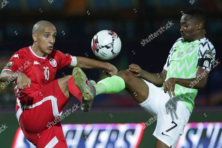 Tunisia's Wahbi Khazri, left, and Nigeria's Ahmed Musa fight for the ball during the African Cup of Nations third place soccer match between Nigeria and Tunisia in Al Salam stadium in Cairo, Egypt