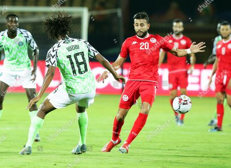 Stock Photo of Tunisia's Ghailene Chaalali (R) in action against Nigeria's Alex Iwobi (L) during the 2019 Africa Cup of Nations (AFCON) third place soccer match between Tunisia and Nigeria in Al-Salam Stadium in Cairo, Egypt, 17 July 2019.