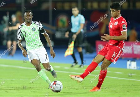 Tunisia's Mohamed Draeger (R) in action against Nigeria's Ahmed Musa (L) during the 2019 Africa Cup of Nations (AFCON) third place soccer match between Tunisia and Nigeria in Al-Salam Stadium in Cairo, Egypt, 17 July 2019.