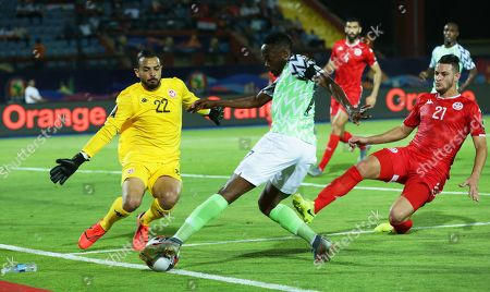 Nigeria's Ahmed Musa (C) in action against Tunisia's goalkeeper Moez Ben Cherifia and Nassim Hnid (R) during the 2019 Africa Cup of Nations (AFCON) third place soccer match between Tunisia and Nigeria in Al-Salam Stadium in Cairo, Egypt, 17 July 2019.